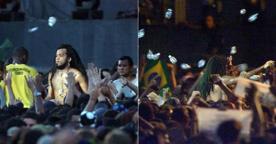 Imagem para MundodeChico - Carlinhos Brown levando garrafada rock Rio 2011